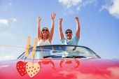 Hearts hanging on the line against crazy couple standing in red cabriolet