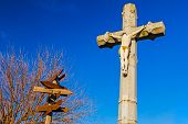 foto of crucifixion  - The crucifixion with directions road made your choice - JPG