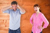 Woman arguing with ignoring man against overhead of wooden planks