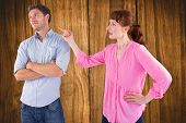 Woman arguing with uncaring man against wooden table