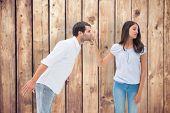 Brunette uninterested in mans advances against wooden planks background