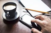 Mobile Phone On Table With Coffee On Side