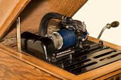 pic of cylinder  - Close up of antique tabletop cylinder phonograph mechanism with blue celluloid cylinder - JPG