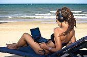 Girl watching movies on the beach