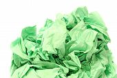 Green crumpled toilet paper on white