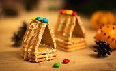 picture of gingerbread house  - beautiful gingerbread house on wooden background with Christmas decorations  - JPG