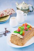 stock photo of yule  - Roulade cake decorated with colourful buttercream flowers - JPG