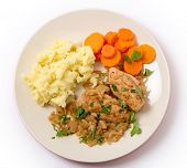 Chicken breasts in an almond, onion and wine sauce, served wth mashed potatoes and carrots