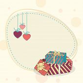 Happy Valentine's Day celebration with hanging hearts and gift boxes.