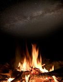 Night scene with fire under stars in sky
