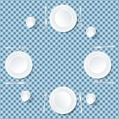 four plates on blue tablecloth