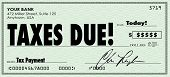 Taxes Due words on a check sent in to government as money owed on revenue or income