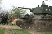 ORECHOV, CZECH REPUBLIC - APRIL 27, 2013: Re-enactors dressed as Soviet soldiers and a Soviet tank T-34 stage an attack at the re-enactment of the Battle at Orechov (1945) near Brno, Czech Republic.