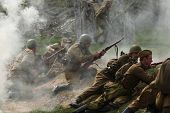 ORECHOV, CZECH REPUBLIC - APRIL 27, 2013: Re-enactors dressed as Soviet soldiers stage an attack during the re-enactment of the Battle at Orechov (1945) near Brno, Czech Republic.