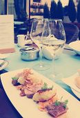 Medium rare fried duck breast on restaurant table, toned image