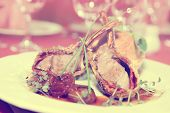 Rack of lamb with caramelized onions and homemade bun, toned image