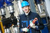 picture of plumber  - industrial construction worker plumber  at boiler room - JPG