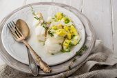 Boiled white fish cod with a sauce based on butter and boiled eggs
