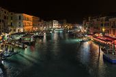 VENICE, ITALY - FEBRUARY 27, 2014: View from the famous Rialto Bridge on evening city of Venice In 2014 the Venetian Carnival was held Between 15 February and 4 March
