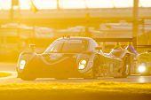 Daytona Beach, FL - Jan 25, 2015:  The RG Racing Riley DP races through the turns at Rolex 24 at Daytona International Speedway in Daytona Beach, FL.