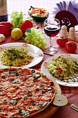 image of italian food  - Classic Italian food setting with pizza pasta salad and wine - JPG