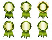 image of rosettes  - Collection of different shaped award ribbon rosettes in green and gold  golden - JPG