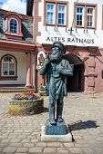 Bronze statue of an ancient wood worker with hammer and saw in Erbach (Odenwald), Germany