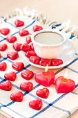 Valentine's Day Cup Of Coffee With Heart Shaped Sweet Chocolates