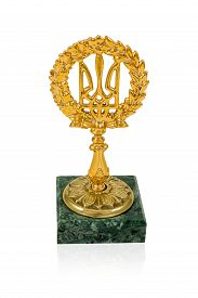 picture of trident  - Cup gold Ukrainian trident emblem on a marble pedestal isolated on white background - JPG