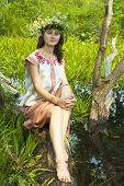 pic of undine  - girl in flowers wreath and traditional clothes near lake - JPG