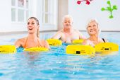 stock photo of gymnastics  - Senior and young people in water gymnastics with resistance device - JPG