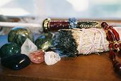 foto of wiccan  - stones sage bundle feather for spiritual ceremonies - JPG