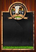 foto of milk products  - Empty blackboard with frame and symbol with head of cow cans for the transport of milk green grass and daisy flowers - JPG