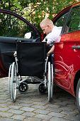 foto of handicapped  - Portrait Of A Handicapped Car Driver With A Wheelchair - JPG