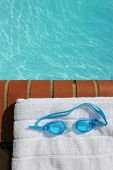 Goggles At The Edge Of A Swimming Pool