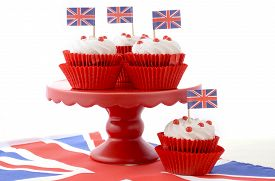 pic of red velvet cake  - Red white and blue theme cupcakes on red cake stand with UK Union Jack flags on white wood table for Queens Birthday and Great Britain party food - JPG