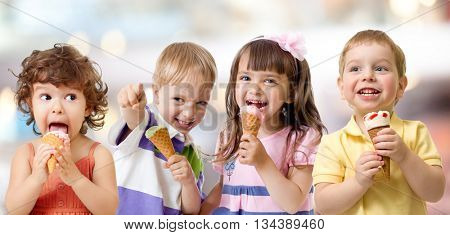 children or kids group eating ice cream