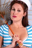 picture of pouty lips  - attractive woman in retro pinup style sailor outfit - JPG