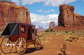 stock photo of stagecoach  - stagecoach in monument valley this is one way to travel back in the old west - JPG