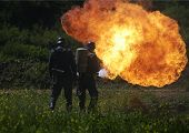 image of flamethrower  - flamethrower in action used by german soldiers - JPG
