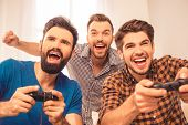 Yeah! Close Up Photo Of Excited Happy Cheerful Men Play Video Game poster