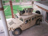 image of humvee  - a hmmwv in iraq posed to defend an american fighting position - JPG