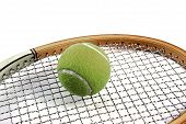 Tennis Ball On Top Of Tennis Racket