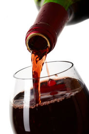 picture of red wine  - Red wine filling a glass - JPG