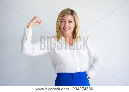 poster of Smiling Mature Caucasian Woman In Formal Blouse Flexing Bicep. Positive Experienced Businesswoman Or