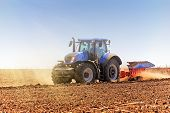 Agriculture. The Tractor Prepares The Ground For Sowing And Cultivation. Agronomy, The Concept Of Fa poster