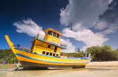 Tropical Seascape With Old And Broken Boat That Ran Aground On White Beach Of Phi Phi Island, Thaila poster