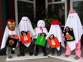 Five Trick or Treat Ghosts on the Porch