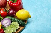 Colorful Still Life Of Fresh Organic Fruits And Vegetables On Wooden Plate Over Blue Background, Sel poster