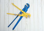Two Adjustable Pipe Wrench Blue And Yellow, Pliers, Wrenches Or Plumbing Tool Lie Cross On White Woo poster